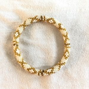 Jewelry - gold and white beaded bracelet